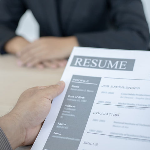 a hiring manager looking over a resume