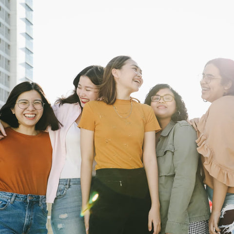 a group of young women smiling and laughing