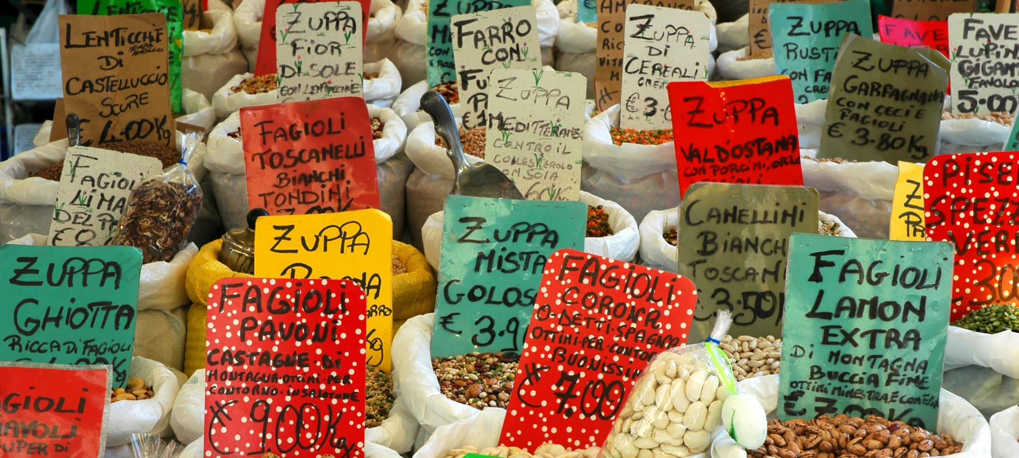 fair trade produce and spices for sale at a market