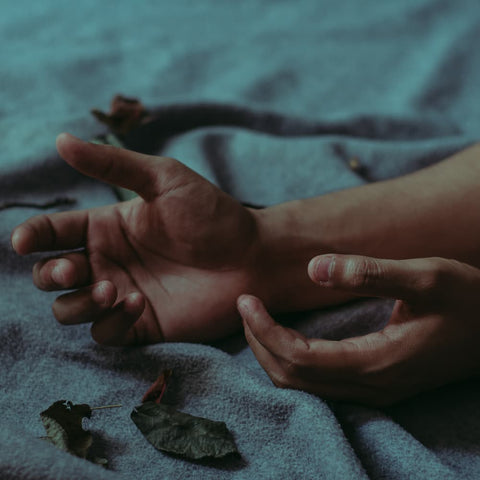 hands of a trafficking victim reaching out for help