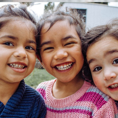 young girls smiling for a photo together