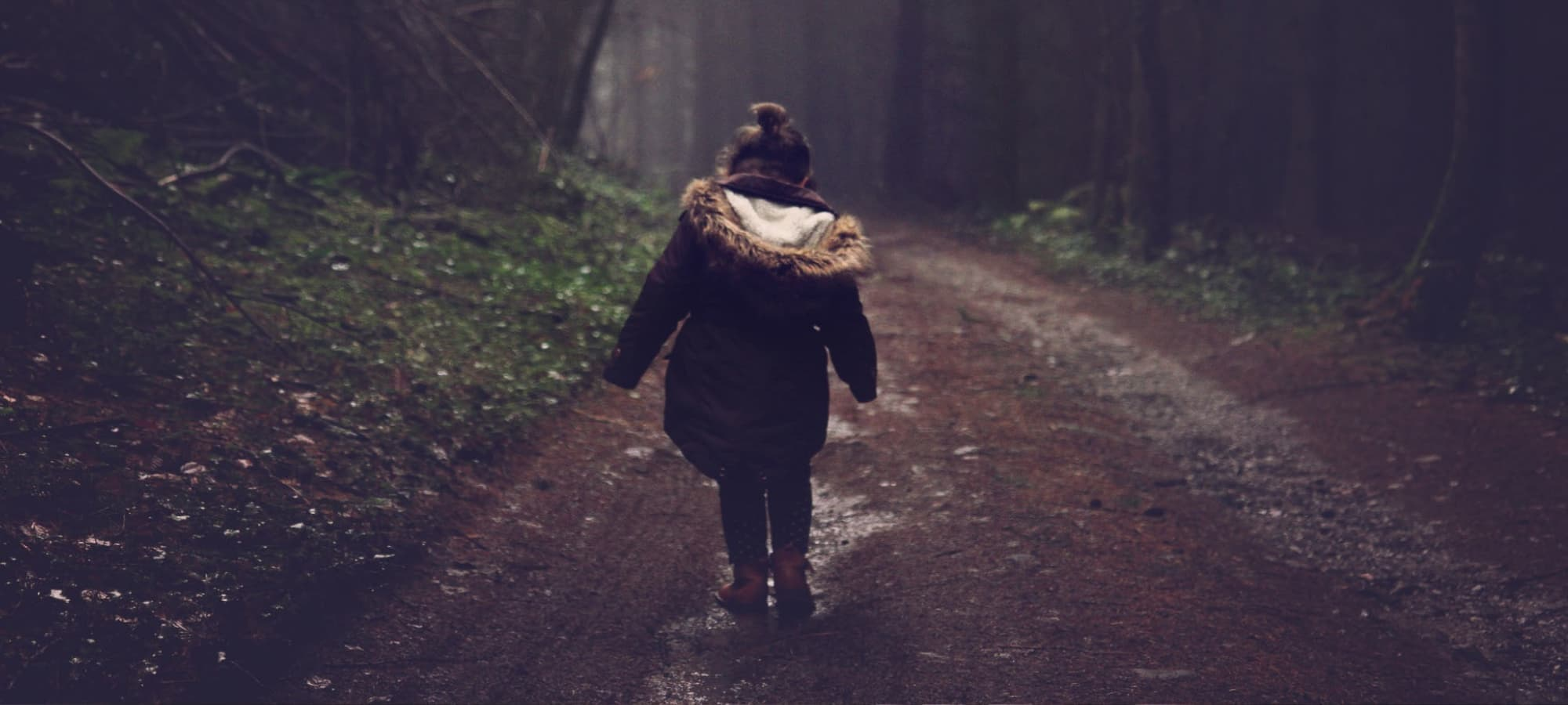an orphan walking by themselves in the woods