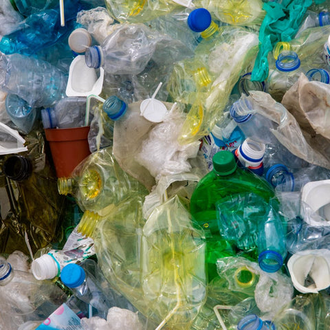 a pile of used plastic bottles and containers