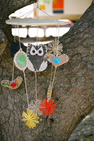 handmade baby mobile featuring an owl and various birds