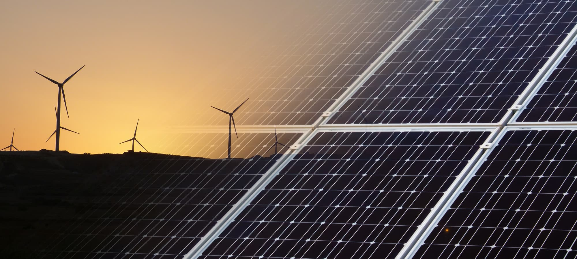 computer image of solar panel fading into a wind farm at sunset