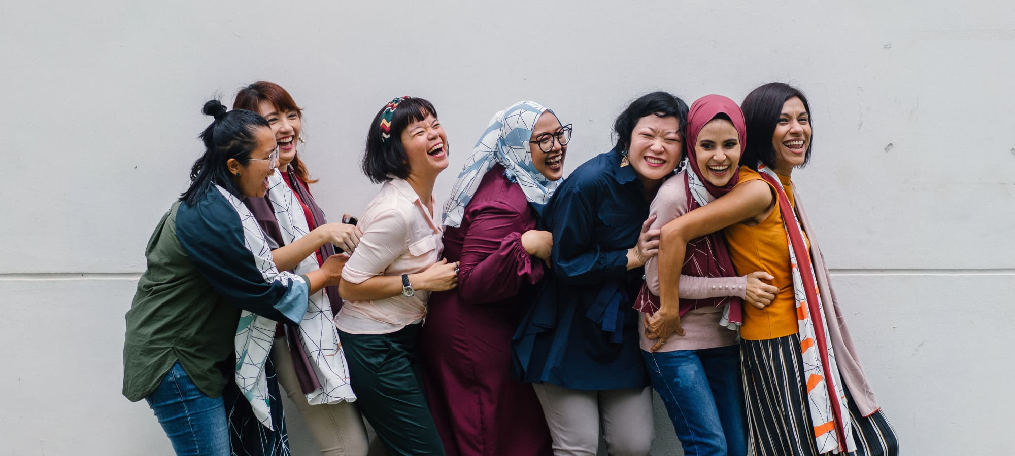 a diverse group of women enjoying each other's company
