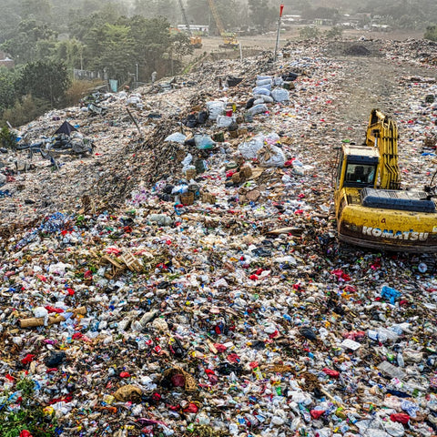highly polluted, industrial landfill overflowing with plastic waste