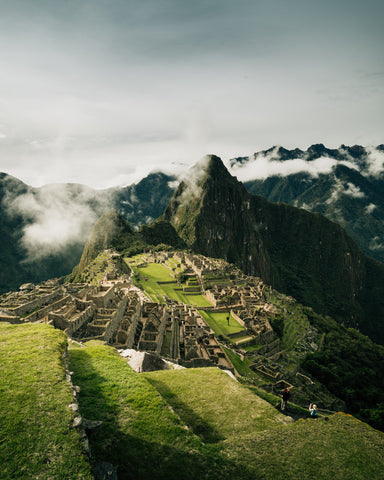 an overlook of Machu Picchu from a foggy cliff