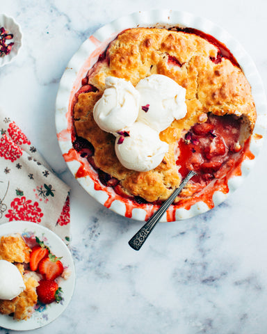 freshly served strawberry pie with whipped cream