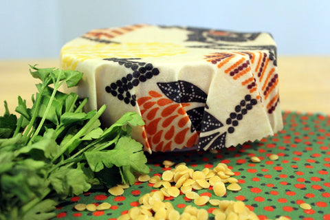 a beeswax wrap for food products with fresh produce and seeds