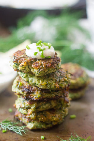 a stack of Vegan Zucchini Fritters with Garlic and Dill