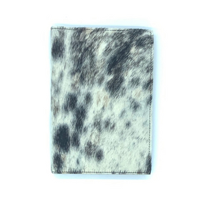A unique black, brown and white cowhide journal handmade in Kenya