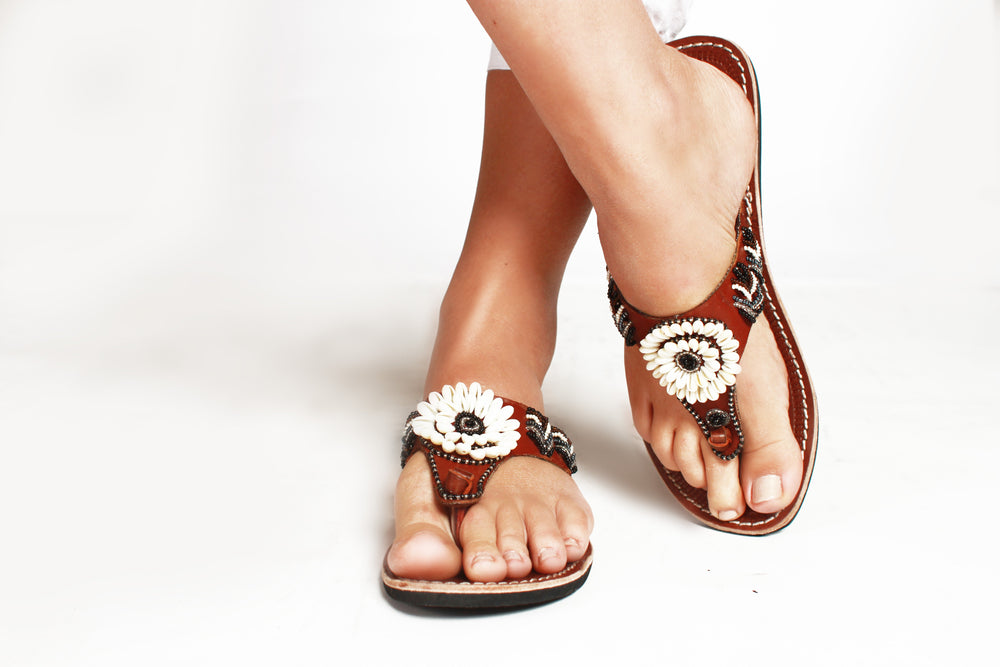 A pair of beaded leather Kenyan sandals that make a difference on a model, the Malkia sandal
