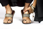 A pair of meaningful grey blue Kenyan beaded leather sandals that give back, the Mkali sandal, on a white background