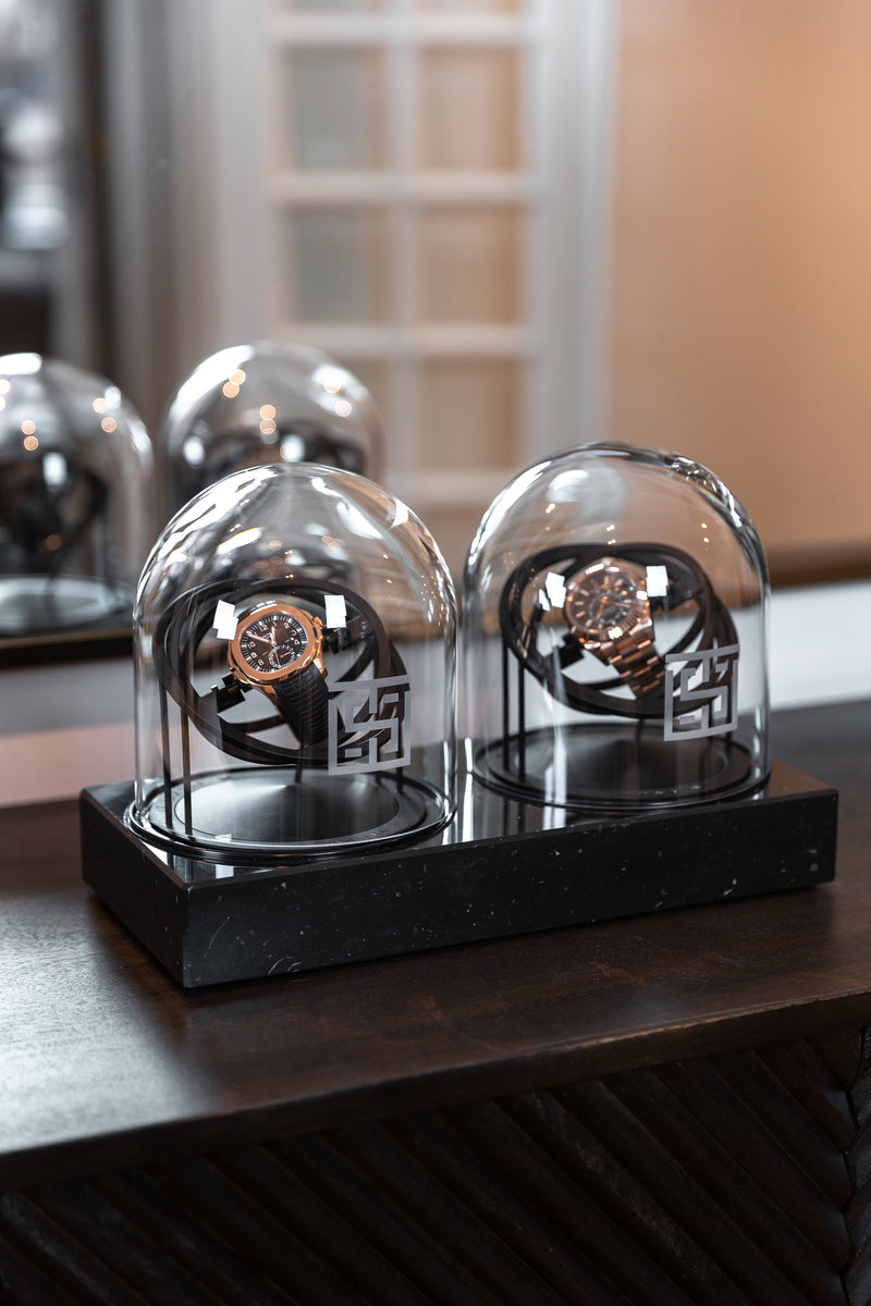 Two Planet Double Axis Black Watch Winder on table