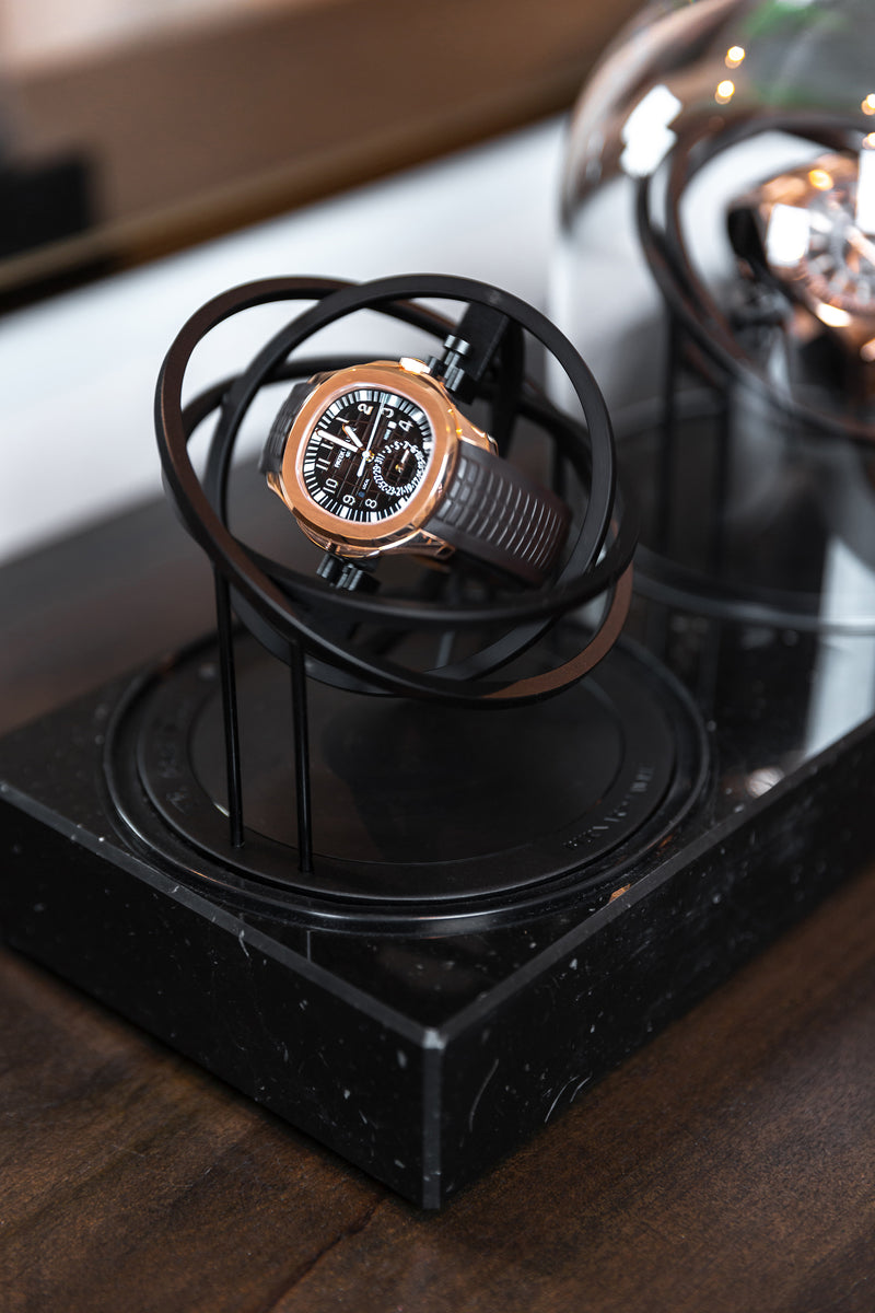Two Planet Double Axis Black watch winder closeup
