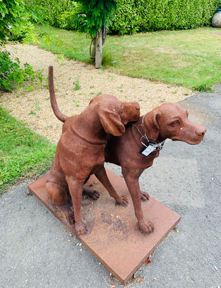 Snuggling Dog Statue