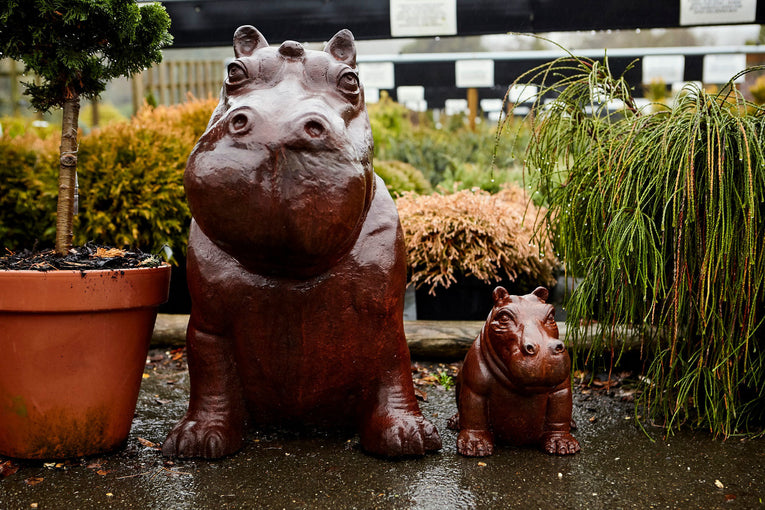 Baby and Mummy Hippo cast iron statues sitting the the nursery