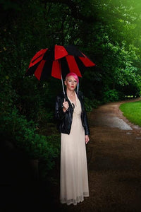 model in rain with umbrella in vintage dress