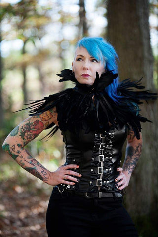 girl modelling in woods blue hair feathers corset