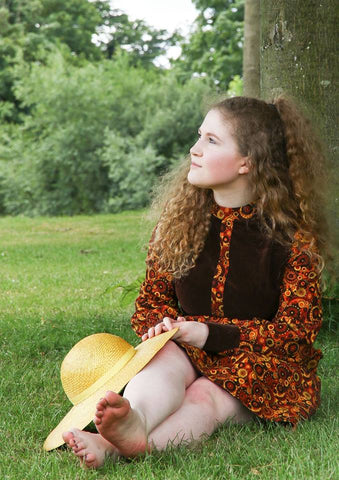 Girl in hippie dress with hat