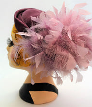 Vintage C&A hat with elastic strap in a lovely dusky purple and the feathers are a lighter purple.