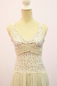 1990s sleeveless Boho style dress. Lined with side zip and floral pattern, Est UK size 10