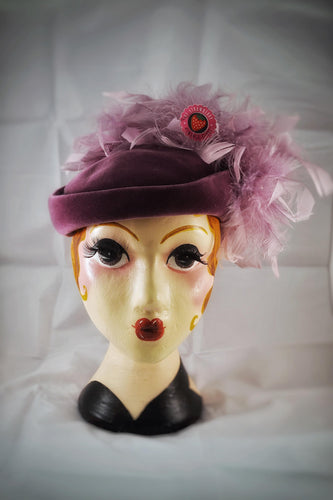 1940s style made 1980s vintage purple feather hat with elastic strap