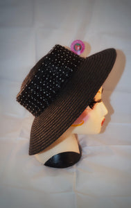 1980s vintage straw hat with flat top and black and white polka dot ribbon trim.