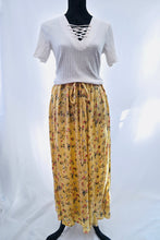 1980s long floral boho skirt, hippie style with flower pattern and waist ties.Yellow
