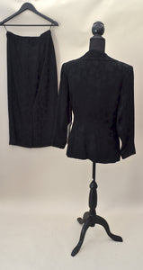1980s Black floral patterned ladies skirt and jacket suit, Est UK size 10