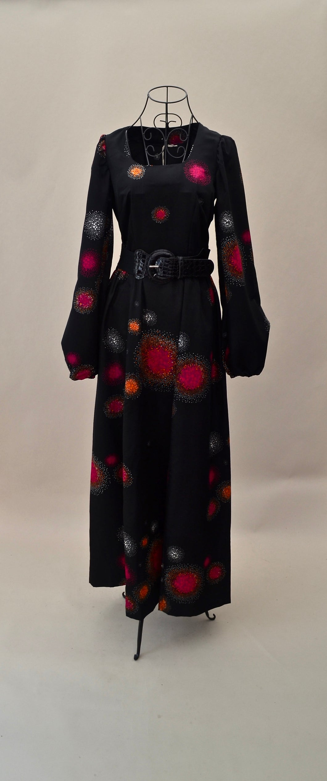 1970s black maxi dress with sleeves and funky vibrant pattern, UK Est size 6/8