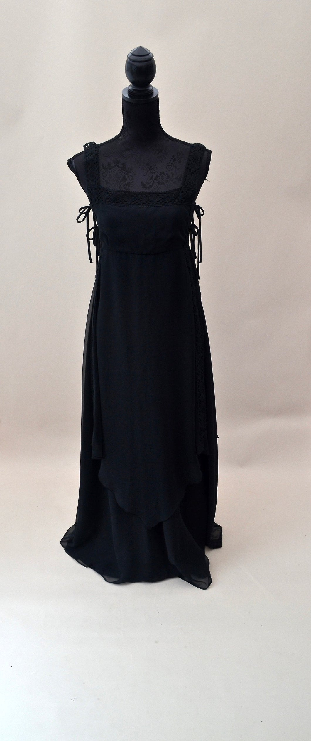 1970s Long black bib dress with side ties, Est UK size 8