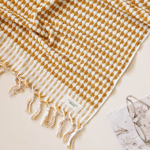 mustard pom pom bath towel by miss April at Unearthed Homewares