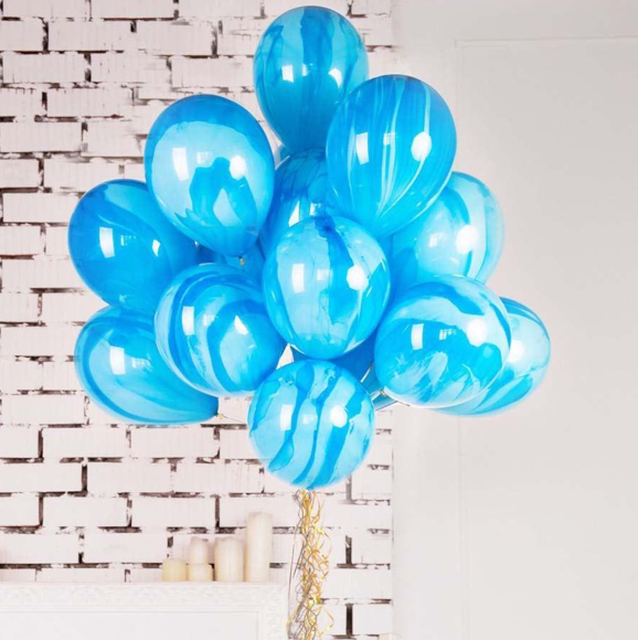 Blue superagate balloon in a bunch with helium.