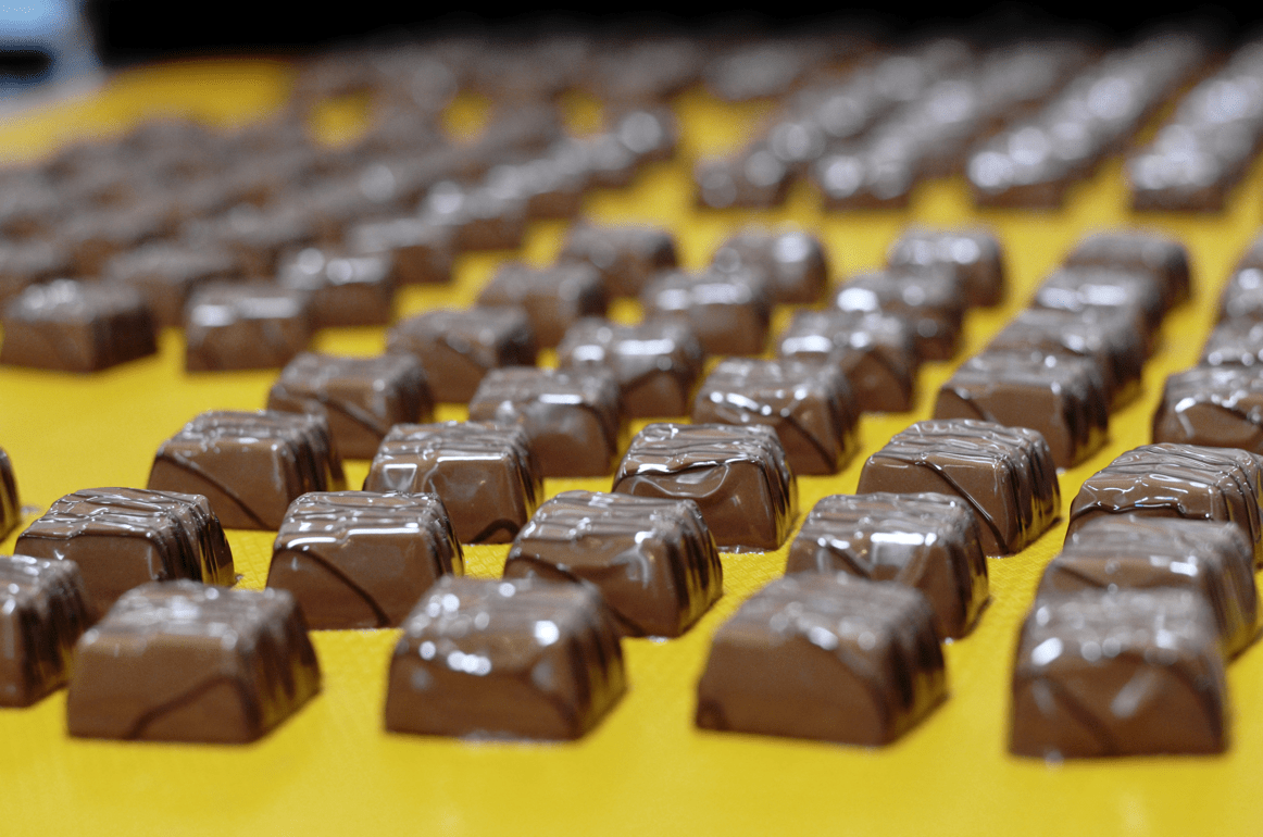 Chocolates on a conveyer belt.