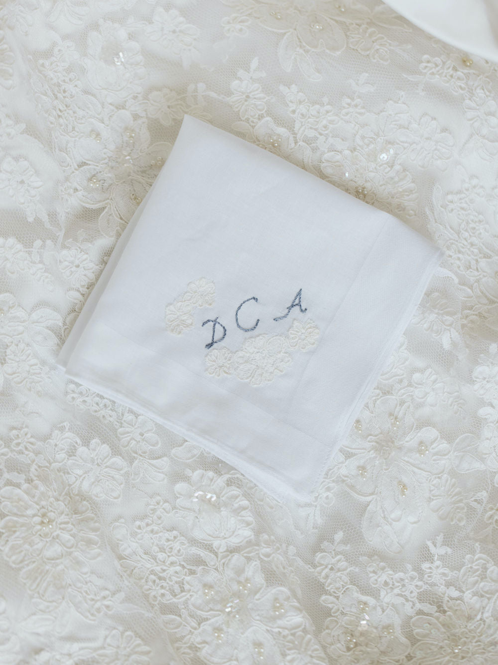 wedding handkerchief made from mother's wedding dress with embroidered monogram by expert heirloom designer The Garter Girl