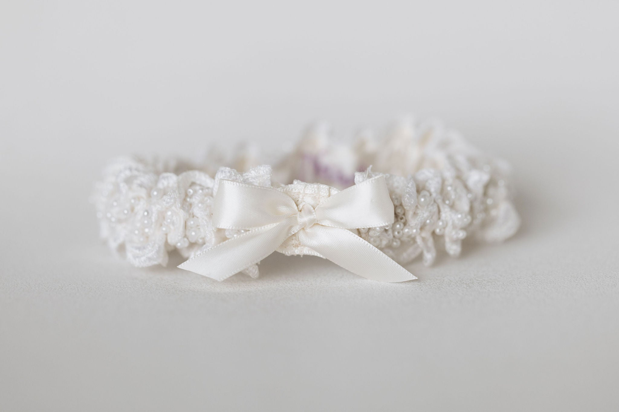 pearls and beaded wedding garter set with personalized hand embroidery handmade by The Garter Girl