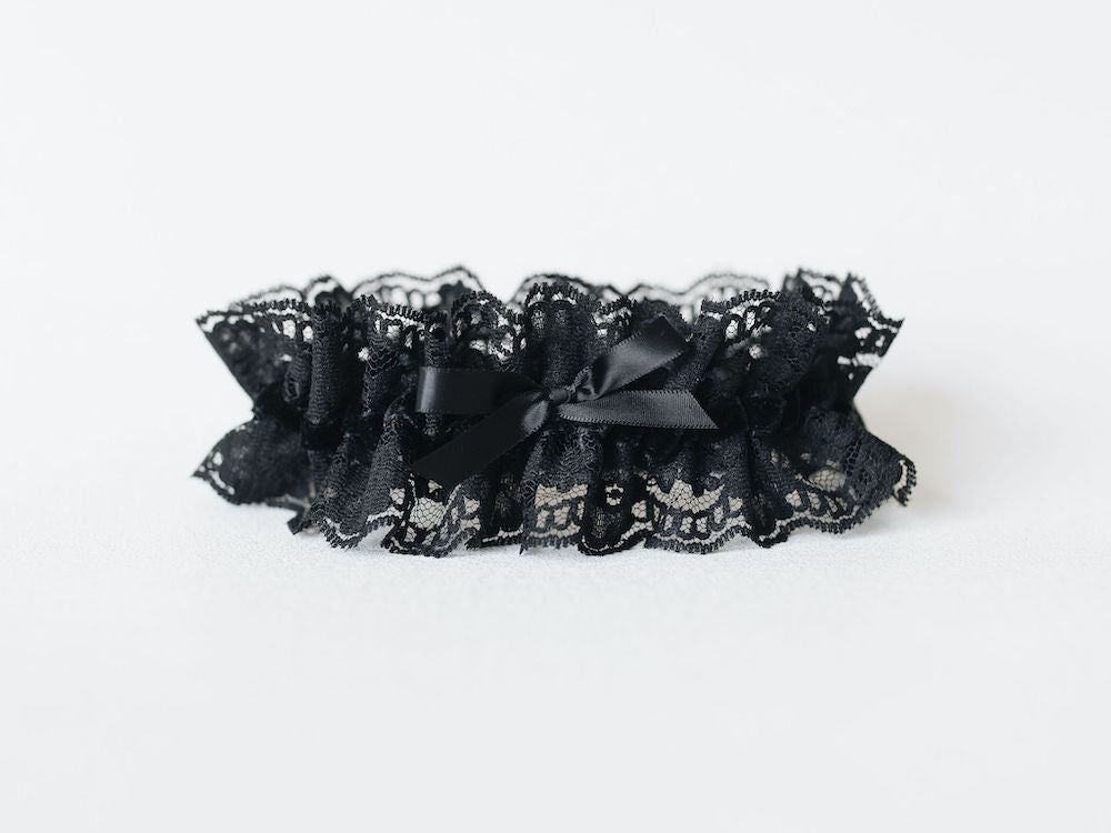 personalized wedding garter with black lace and velvet and custom red embroidery by heirloom designer, The Garter Girl