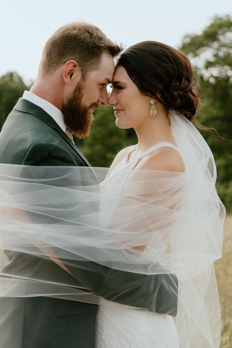Bride and Groom Tulle Veil Outdoors