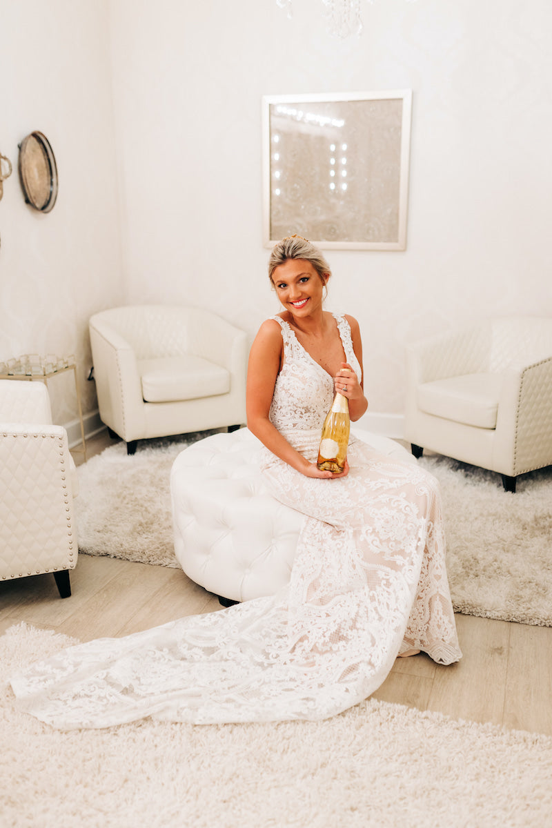 Bride with Champagne in Bridal Suite