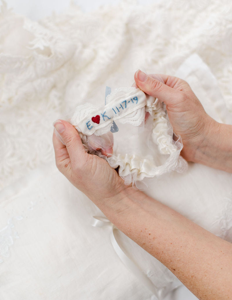 custom wedding garter and ring pillow made from mother's dress and grandmother's handkerchief