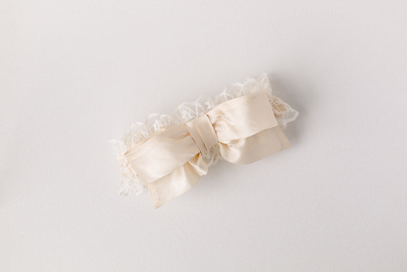 personalized wedding garter made from mother's wedding dress