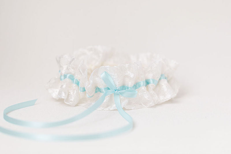 custom wedding garters for sisters made from their mother's wedding dress lace