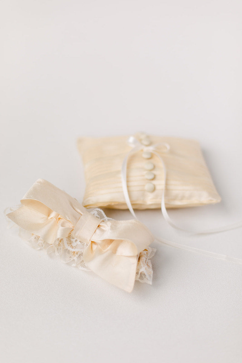 personalized wedding garter and ring pillow made from mother's wedding dress