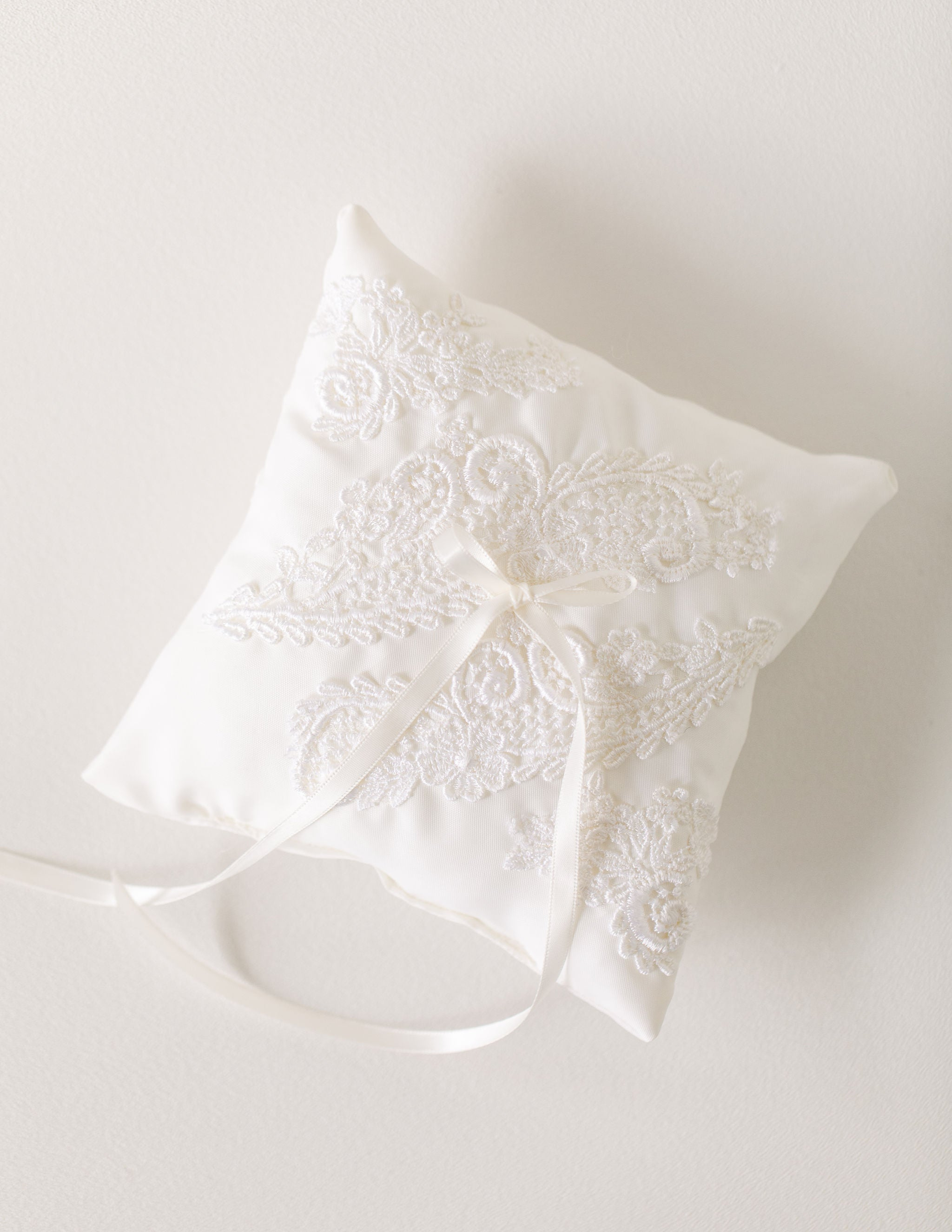 wedding garter and ring pillow made from the bride's mom's wedding dress sleeves by The Garter Girl