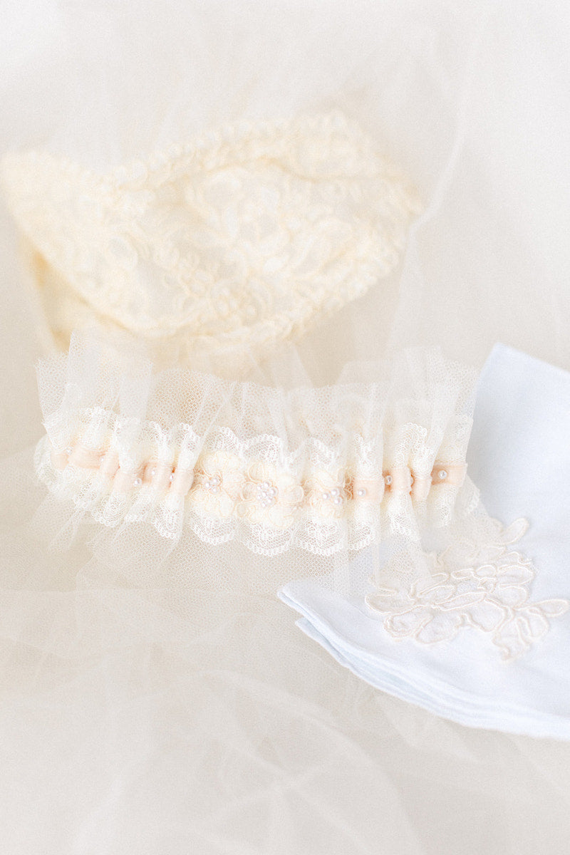wedding garter and handkerchief made from bride's mother's veil