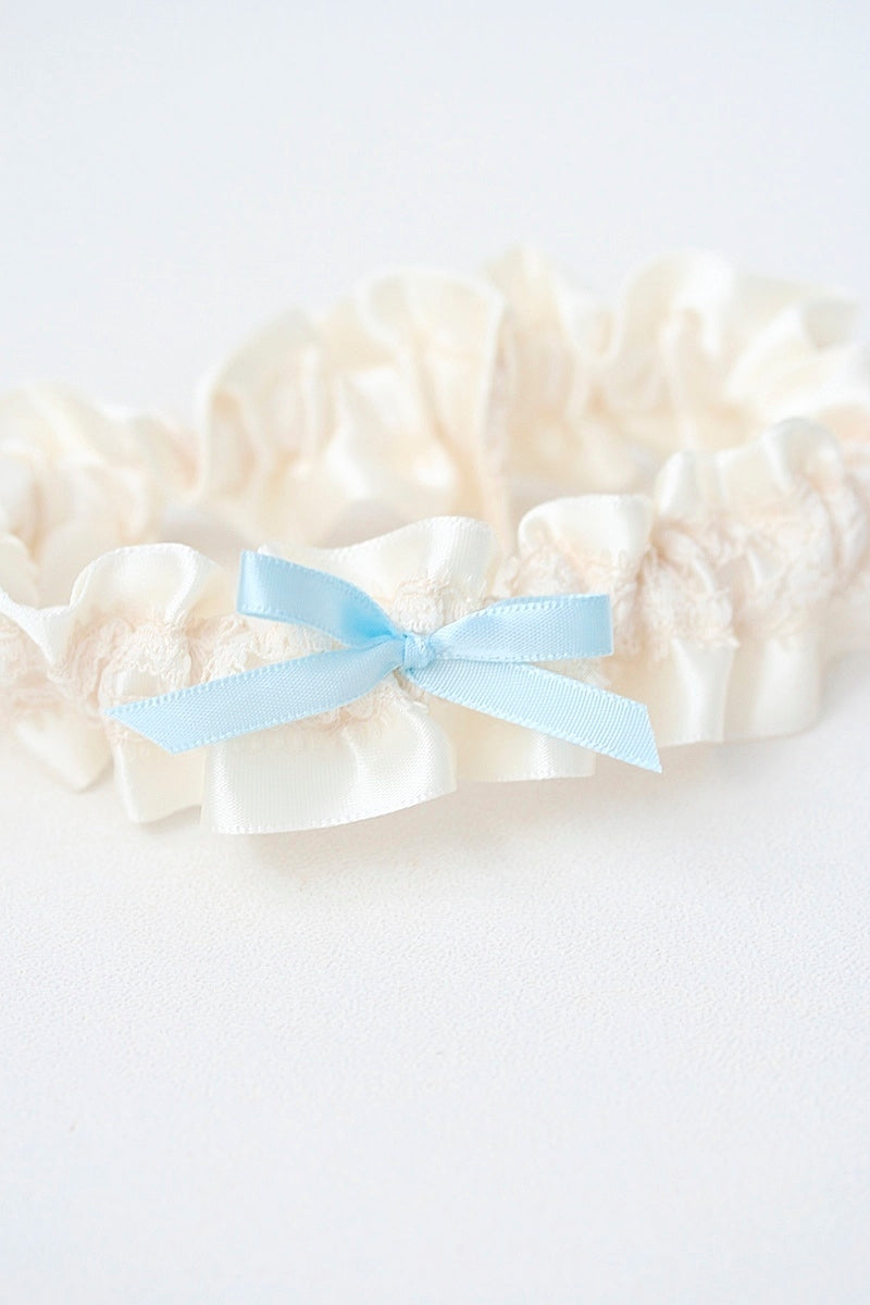 custom wedding garter with ivory lace and blue bow