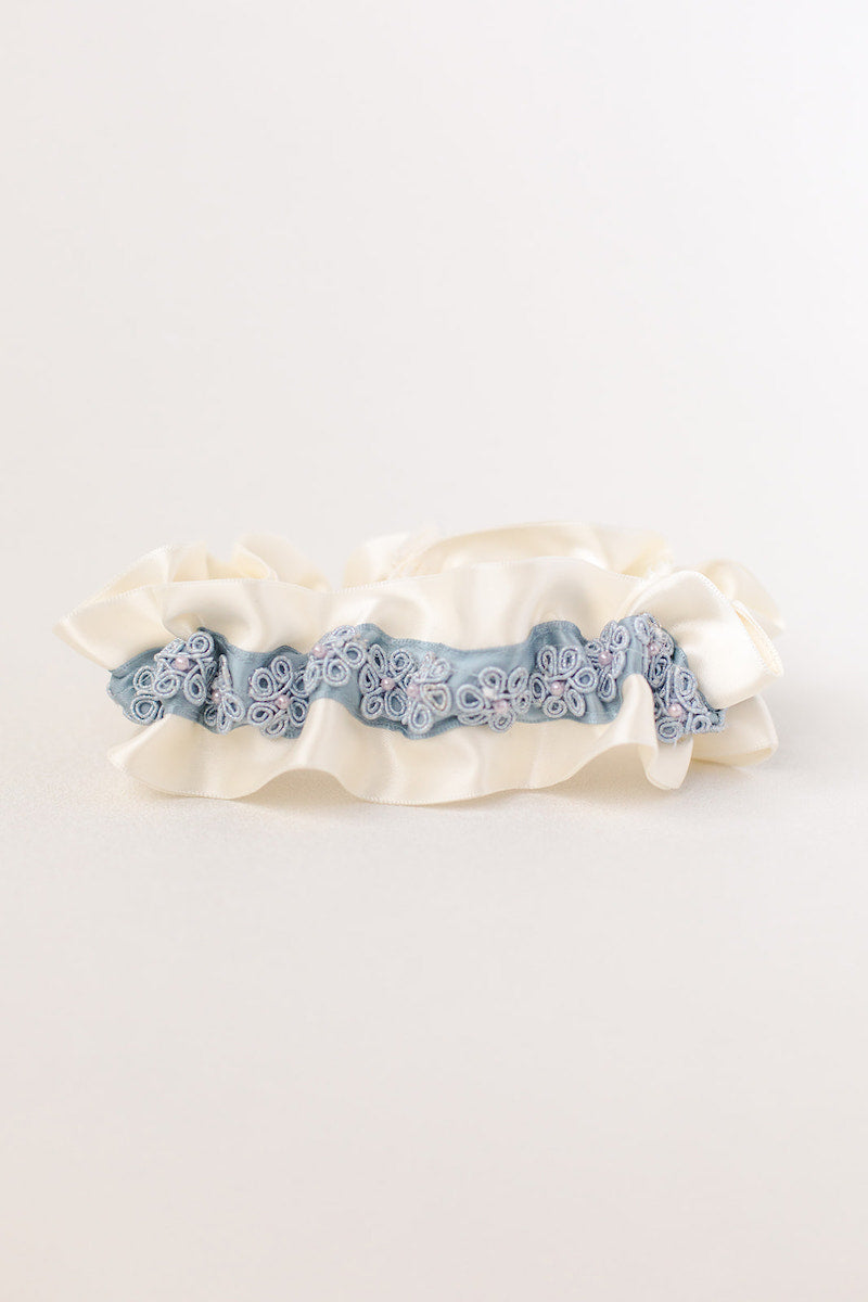 custom garter with dusty blue flowers and pearls