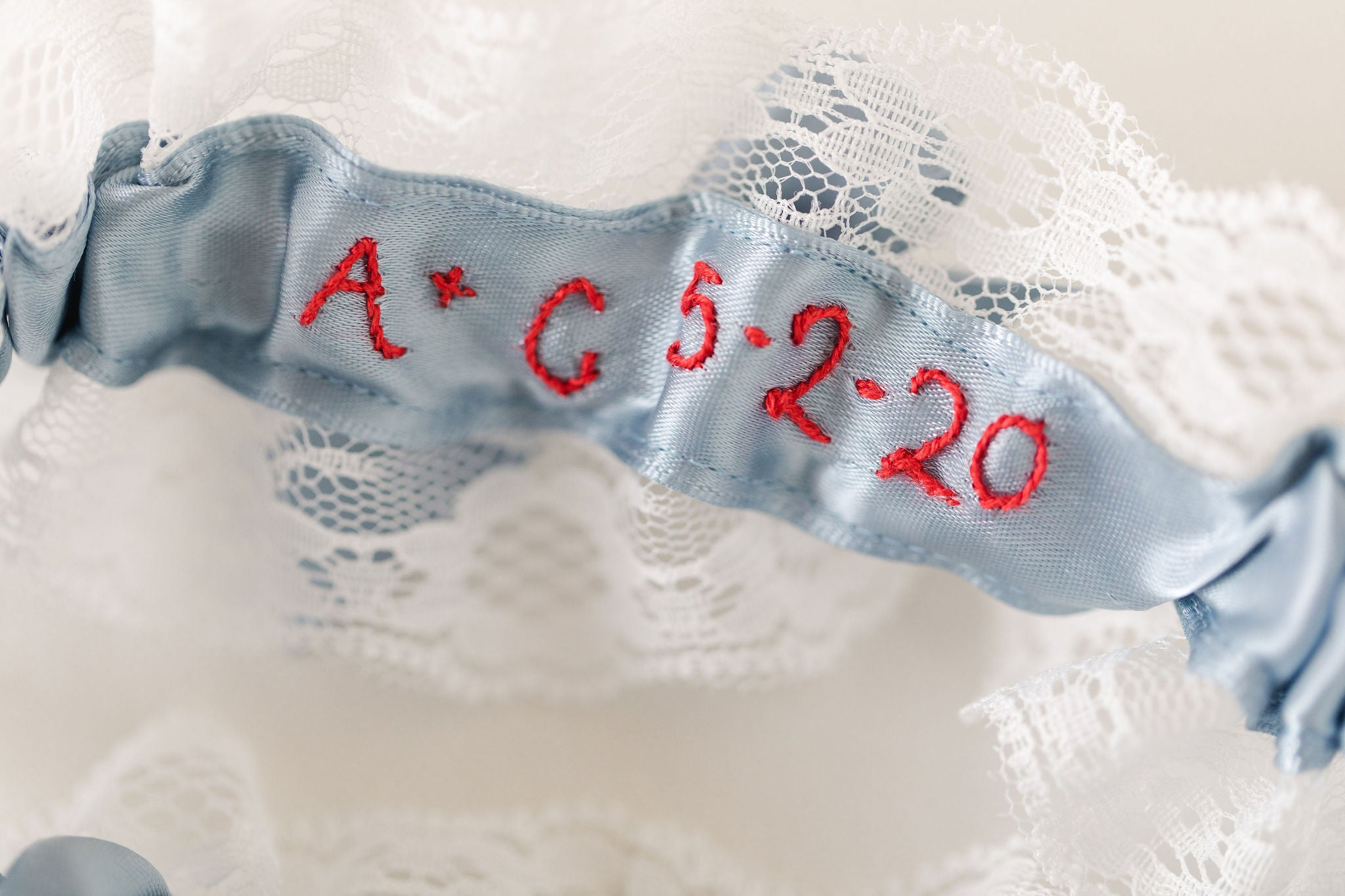 custom lace wedding garter set with personalized embroidery handmade by The Garter Girl